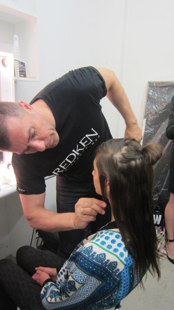 """""""There is a really low side part as it's a bit tougher, too. Once done, we are going through with Redken Smooth Lock Heat Glide and we are just applying it to some of the hair for a semi wet look. Again, that provides a bit of toughness rather than it being too glamorous. Define it and create that piecey, semi wet look and then finish with Redken 23, a strong hold hairspray to toughen up the side part even more and really accentuate it, so when the light hits it, it's much stronger."""""""