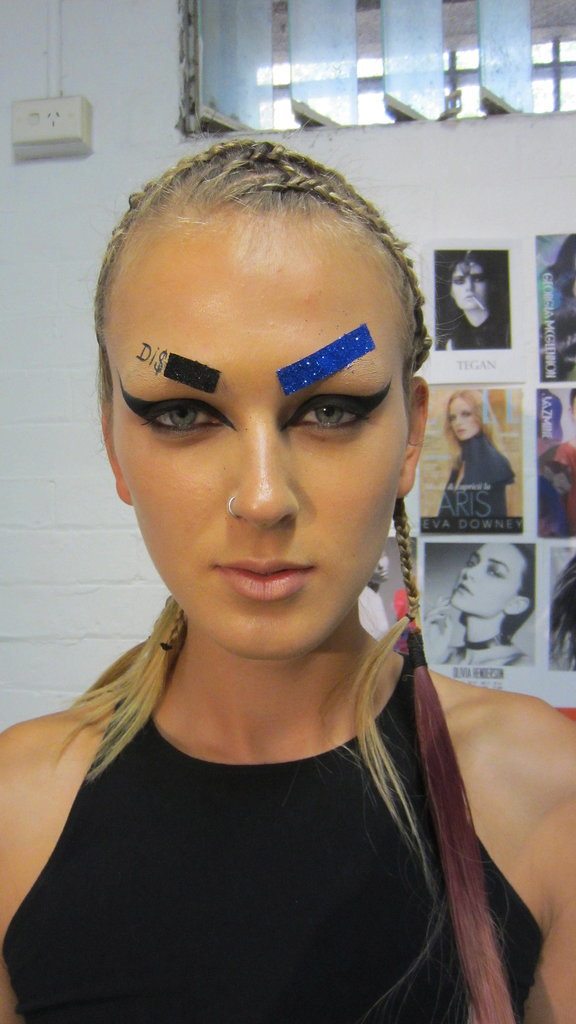 """Mac Cosmetics' Nicole Thompson says, """"Discount Universe are known for all their colour and texture, so we have done a real caty, hip-hop, cartoon-style look and not made it too perfect. We are applying all these great statement moments that we are careful with (like the liner), but the rest of it is kept haphazard and young.  We will then be smudging the liner under the eyes as we want them to look a little bit dirty and have a little roughness to them."""""""