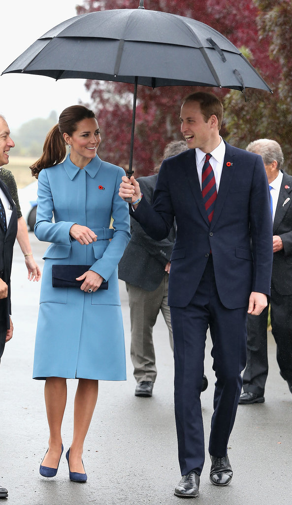 Kate and William shared a laugh in the rain on their way to the Omaka Aviation Heritage Centre in Blenheim, New Zealand, in April 2014.