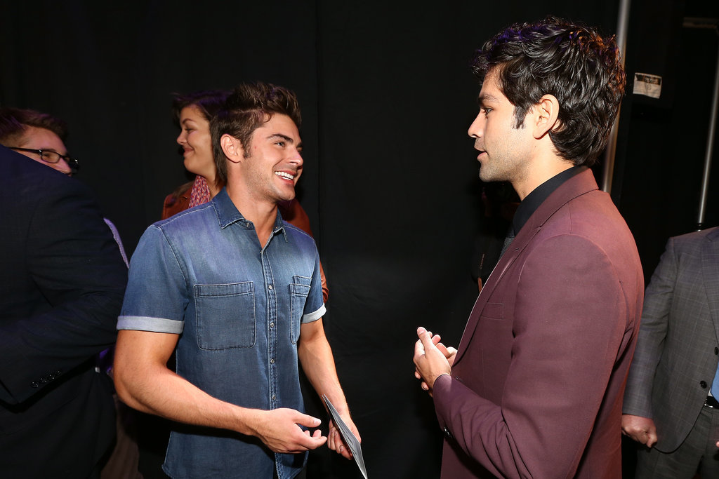 Zac Efron had a laugh with Adrian Grenier.