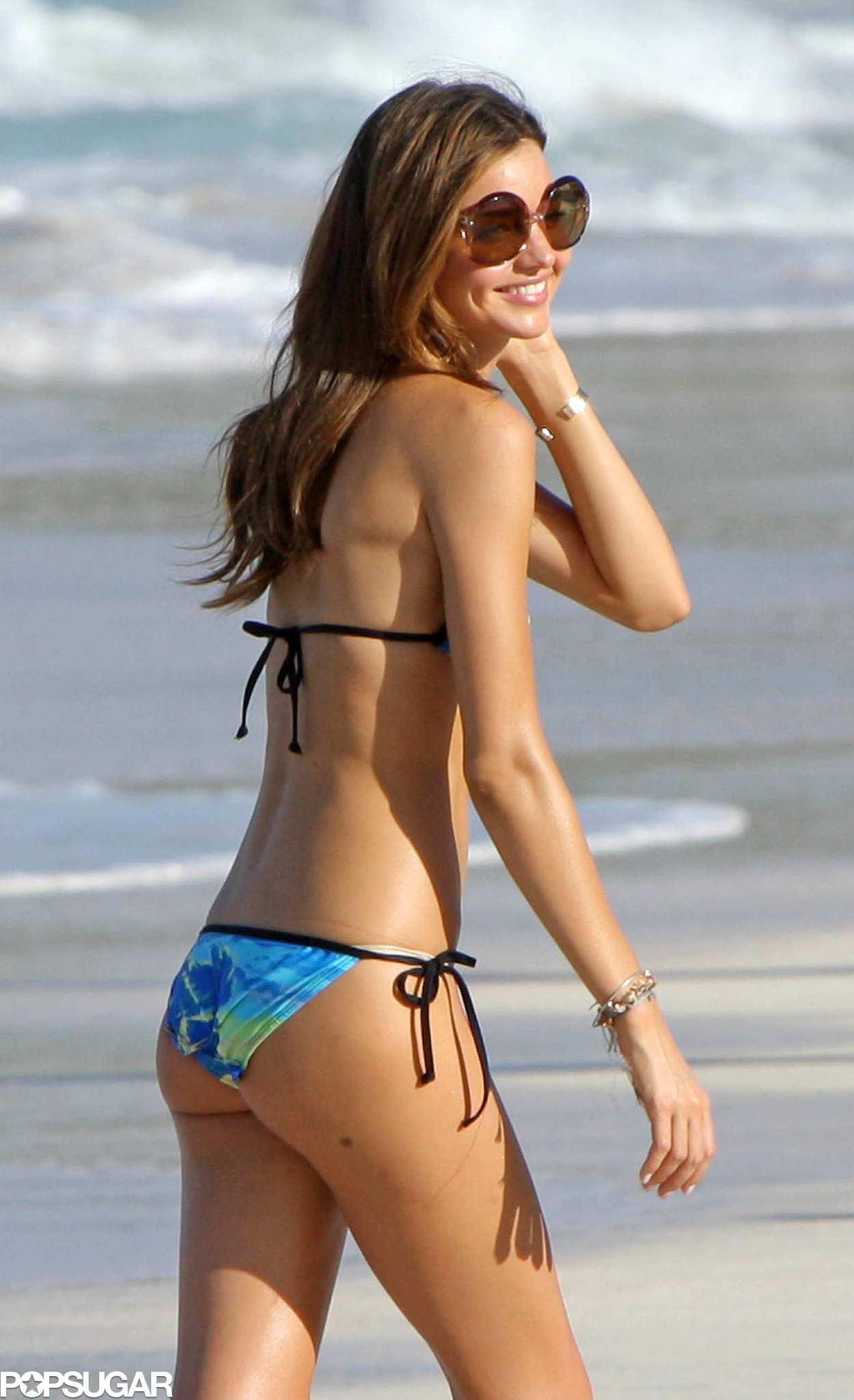 Miranda had a grin on her face during a 2008 beach stop in St. Barts.
