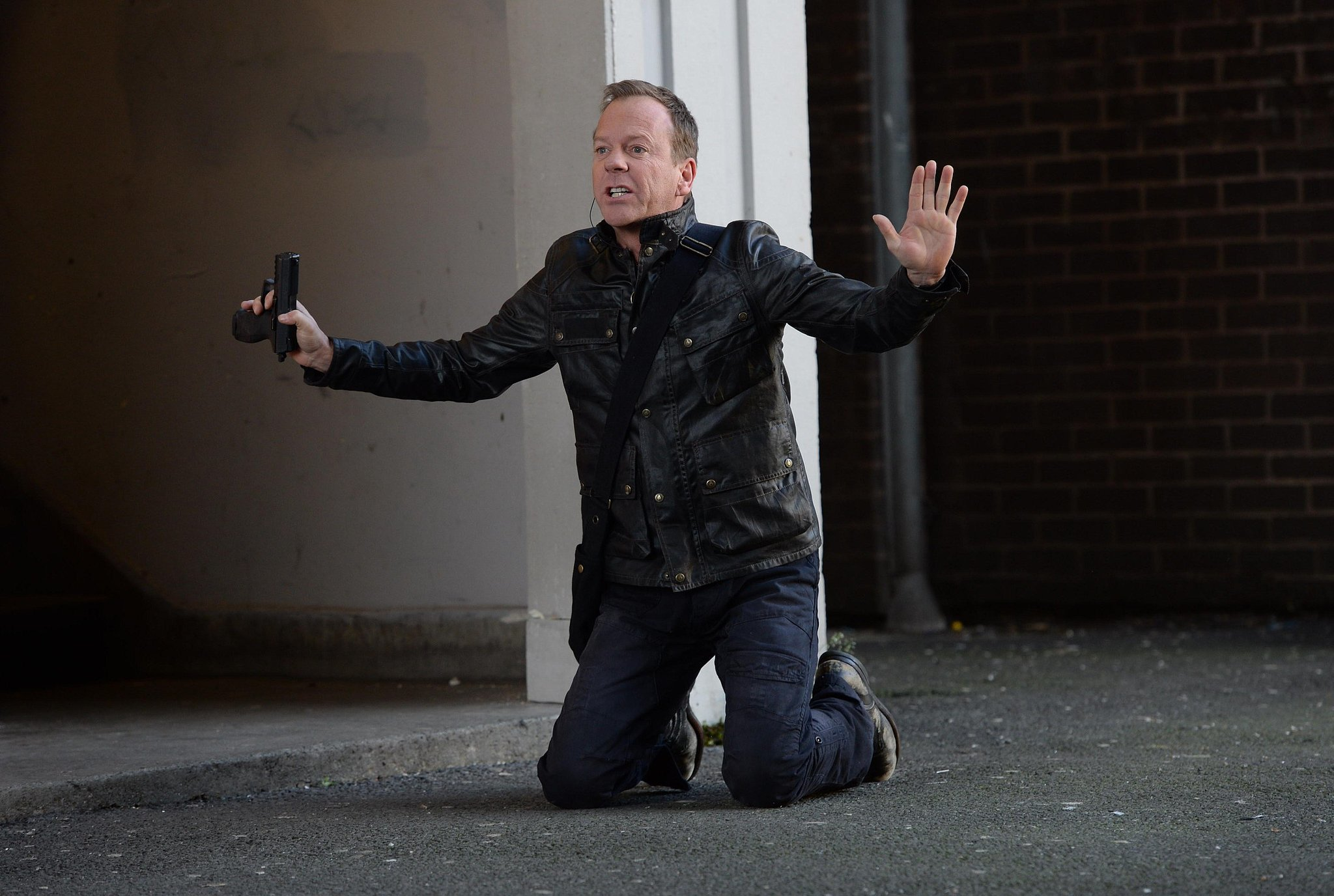 Kiefer Sutherland takes a knee as Jack Bauer.