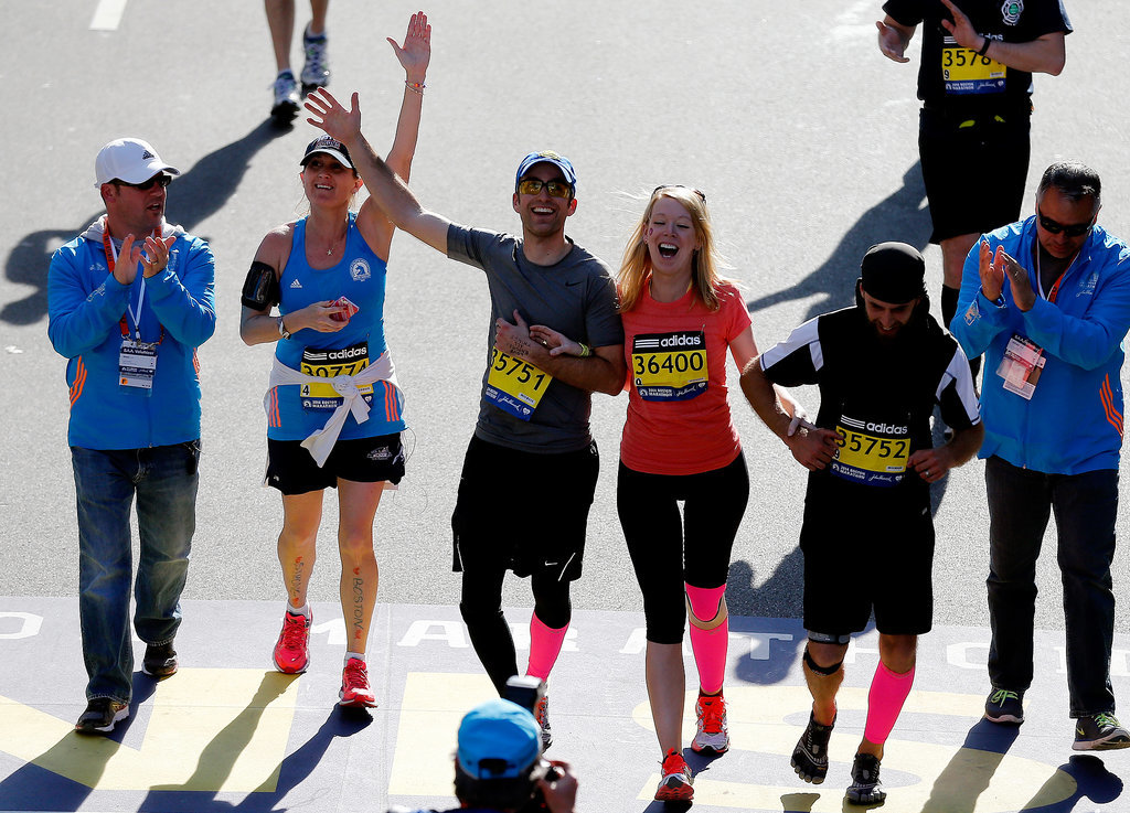 Boston Marathon bombing survivor Adrianne Haslet-Davis was all smiles while finishing the race, holding on to her loved ones.