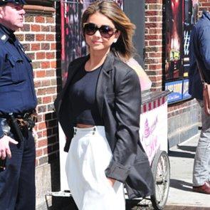 Sarah Hyland Wearing White pants and Navy Crop Top