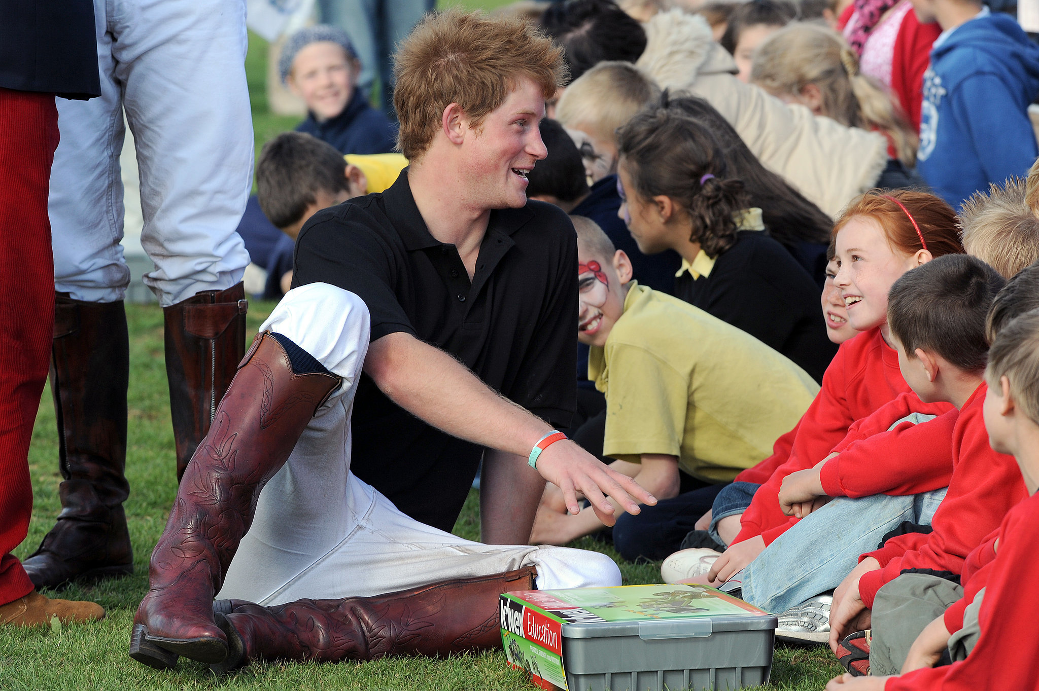Prince Harry charmed local children after competing in a charity polo match in 2008.