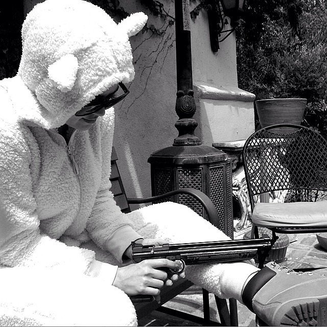 Khloé Kardashian wore this crazy animal suit and held a gun. Source: Instagram user khloekardashian
