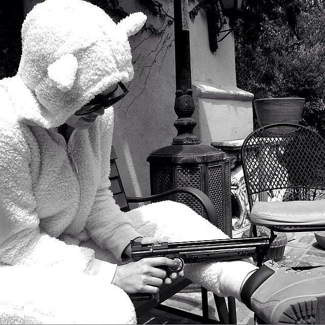 Khloé Kardashian wore this crazy animal suit and held a gun. Source: Instagram user khloekardashian