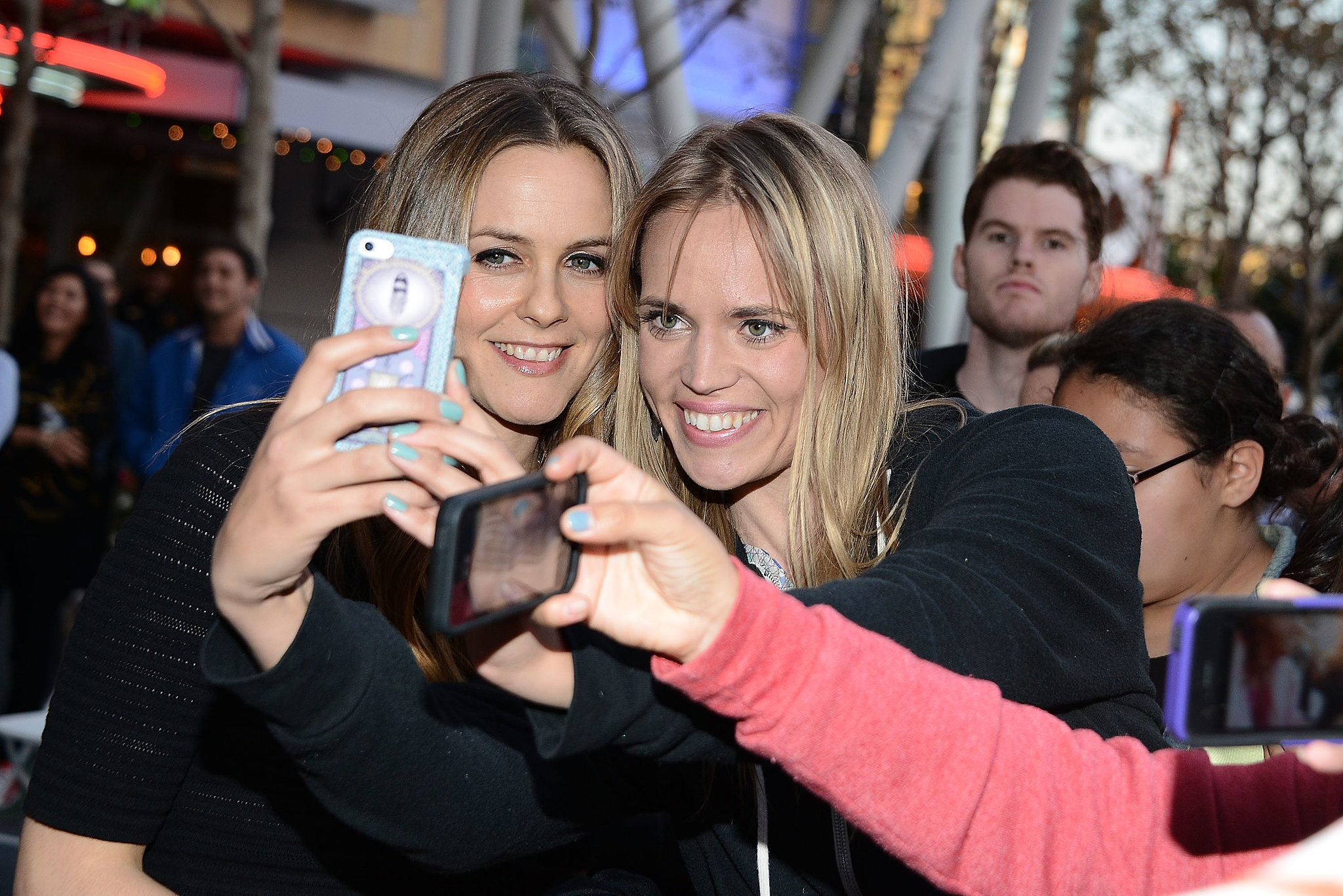 Alicia snapped a selfie with a fan.
