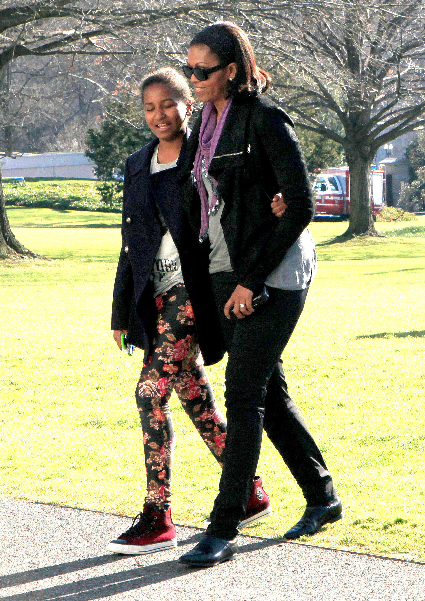 Michelle and Sasha showed off their similar style in early 2013.