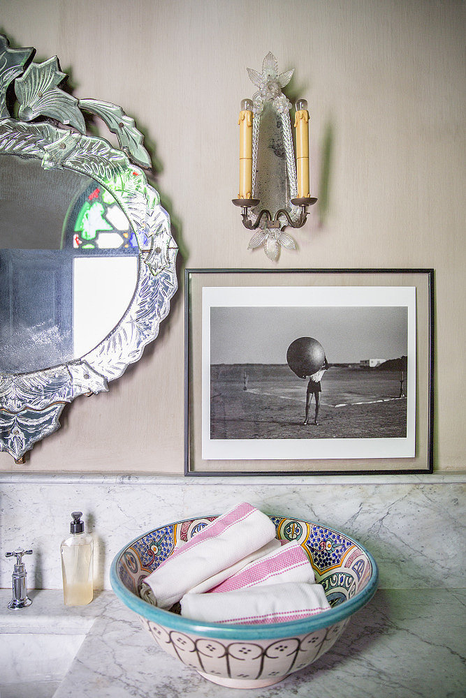 Instead of storing linens out of sight, put them on display. A decorative bowl makes a unique alternative to a tray or towel rack.  Source: Domino