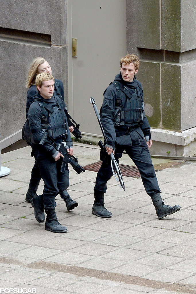 Josh and Natalie walked with Sam Claflin for a battle scene in Paris.