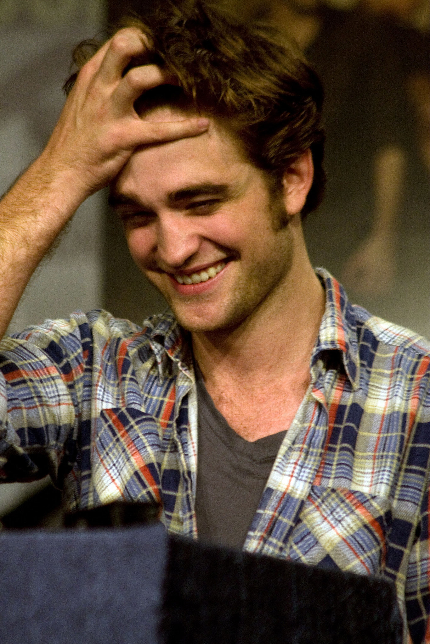 Old habits die hard for the New Moon star, who couldn't help playing with his hair during a July 2009 press conference in San Diego.