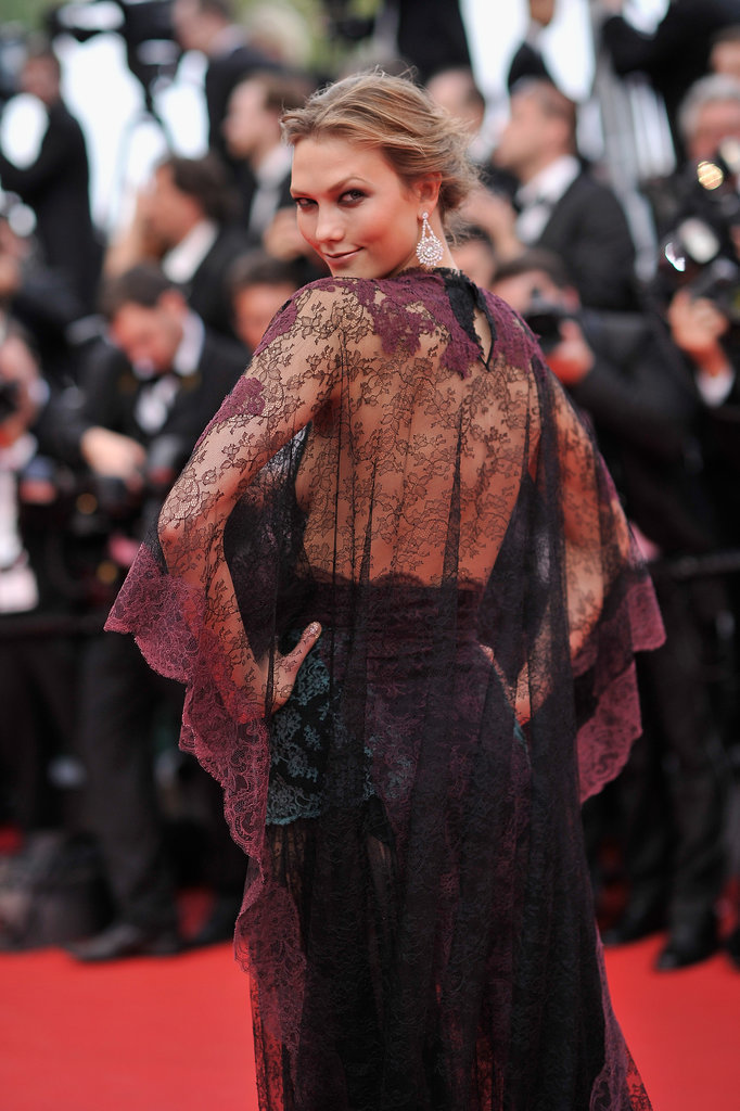 Karlie Kloss attended the opening ceremony in a lacy, burgundy Valentino dress.