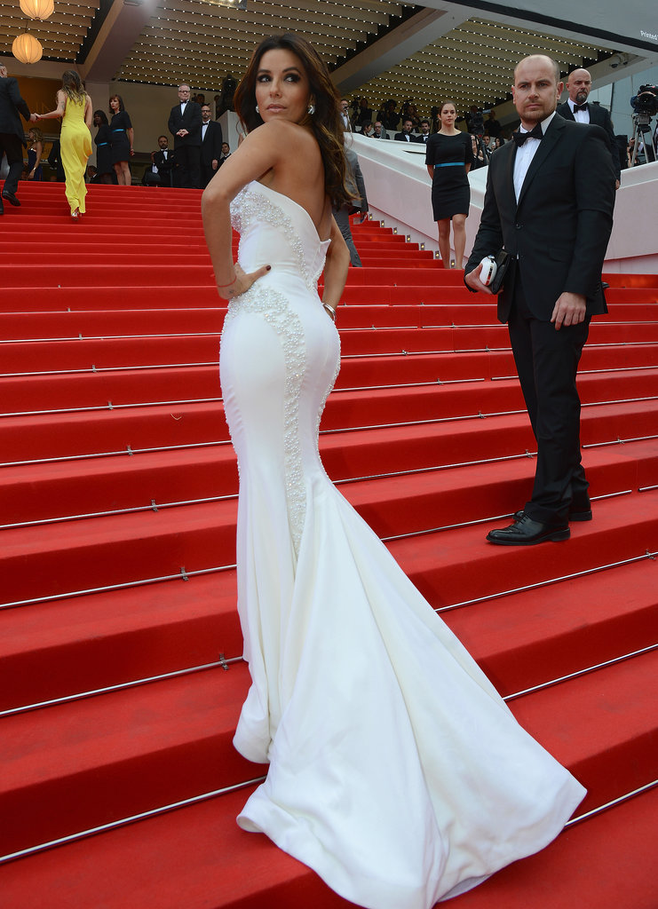 Eva Longoria's long train cascaded down the steps at the Saint Laurent premiere on Saturday.