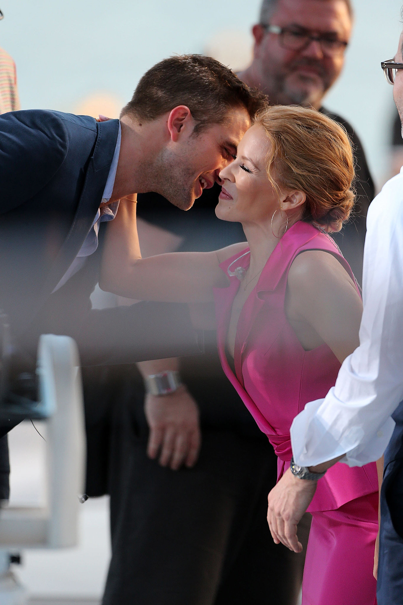Robert Pattinson exchanged cheek kisses with Kylie Minogue when they both appeared on Le Grand Journal in Cannes on Tuesday.