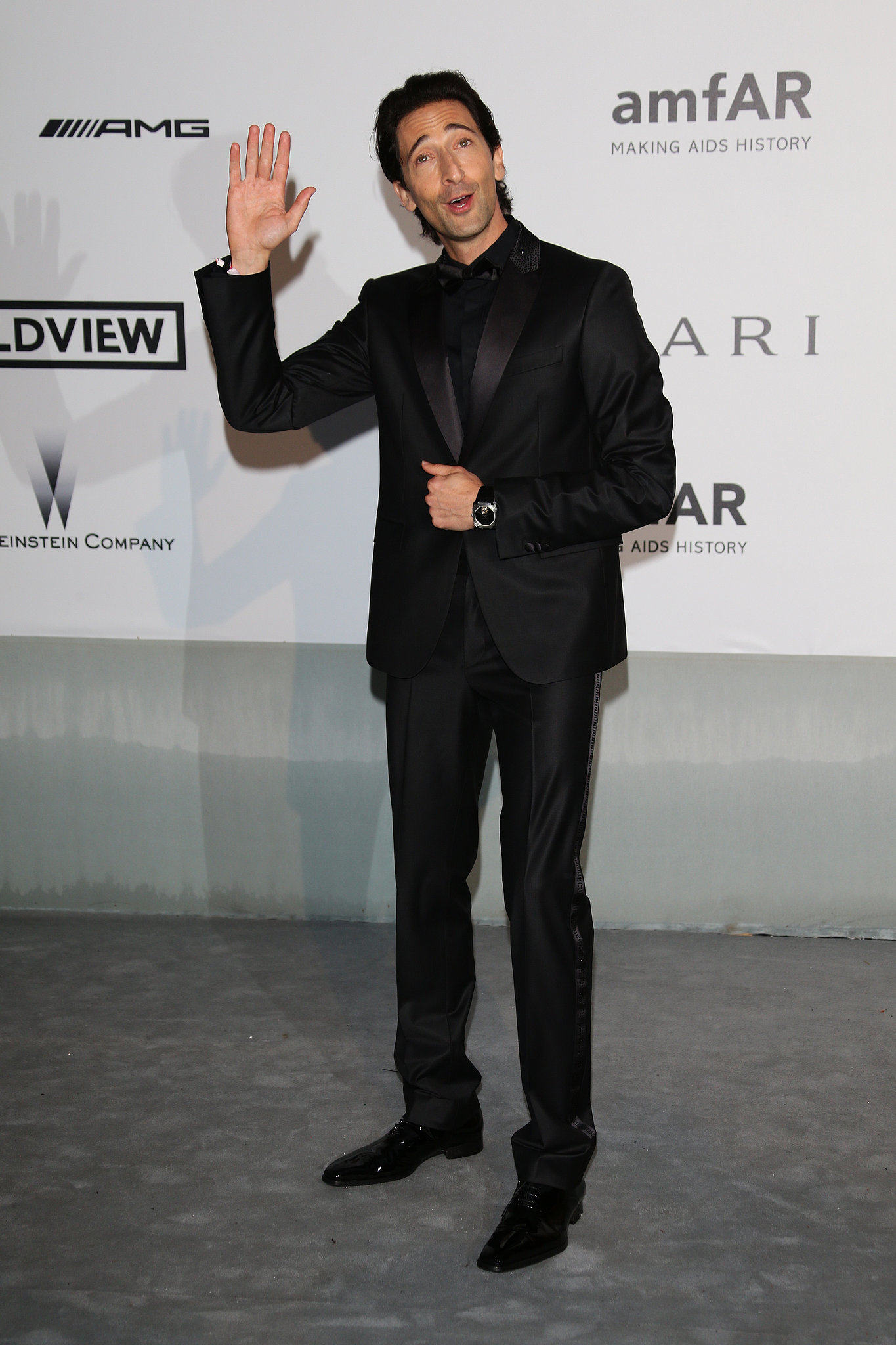 Adrien Brody waved to the photographers.