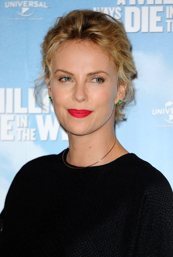 Charlize Mixes Work and Fun With Sean in London