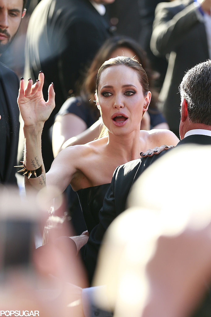 Angelina was signing autographs nearby.