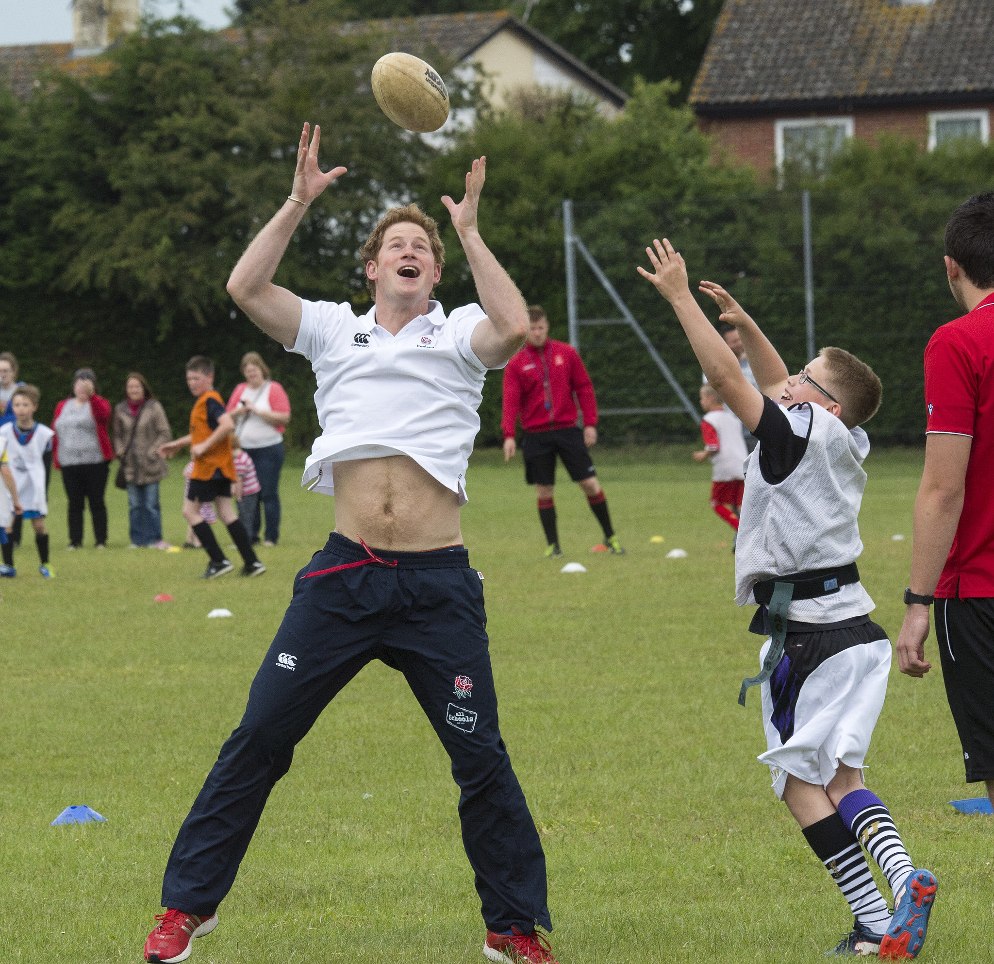 Newly single Prince Harry gave everyone a glance at his royal abs when he took part in an activity day in the Suffolk region of England.