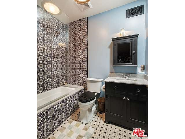 Eye-catching tiles turn the bathtub into a focal piece for the room.  Source: Coldwell Banker