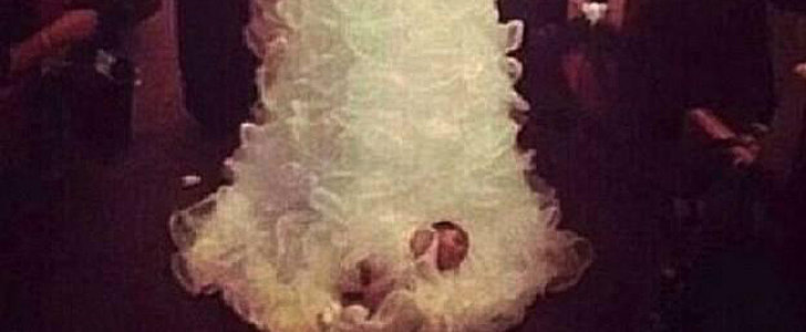 Bride-to-Be Ties Her Baby to Her Wedding Gown!