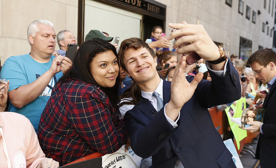 The Fault in Our Stars' Ansel Elgort snapped a selfie with a fan in NYC in June 2014.