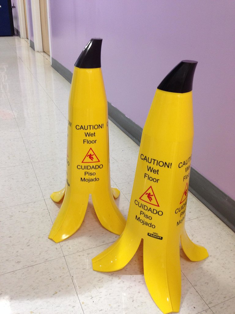 """Banana peel wet floor signs."" Source: Reddit user ShutUpLori via Imgur"