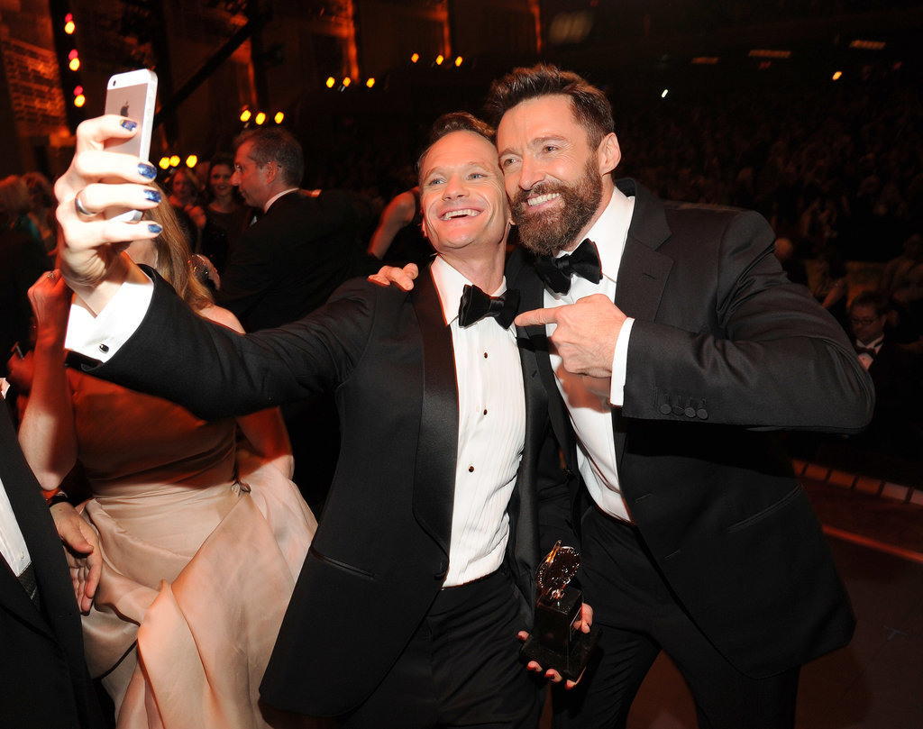 Neil Patrick Harris and Hugh Jackman snapped a selfie at the Tony Awards in NYC on Sunday. Later that night, Neil gave a showstopping performance as his character from Hedwig and the Angry Inch, which featured him giving Sting a lap dance!
