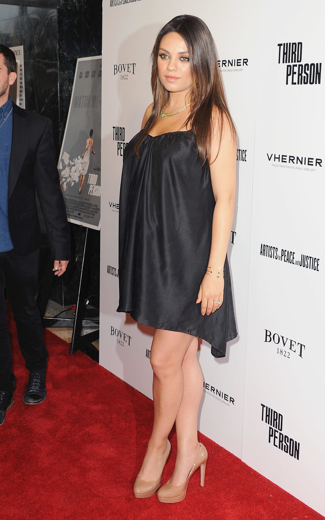 Mila Leaves Ashton at Home to Bring Her Baby Bump to the Red Carpet