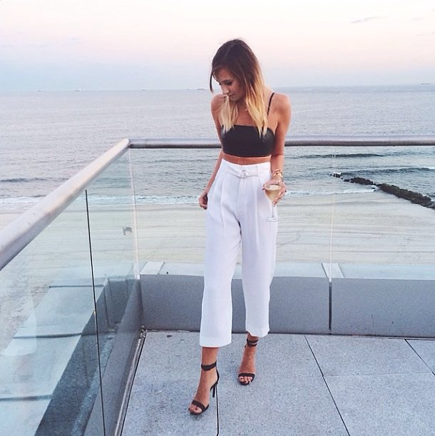 Wow your date with something a little more unexpected — try a crop top and high-waisted pants, then add in your sexiest heels.  Source: Instagram user weworewhat