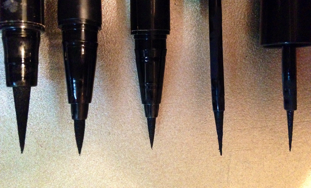 The Revlon Skinny Liner is on the far right, and clearly boasts the slenderest brush from base to tip out of all of them.  What's more, this product also features a raven-black formula that dries