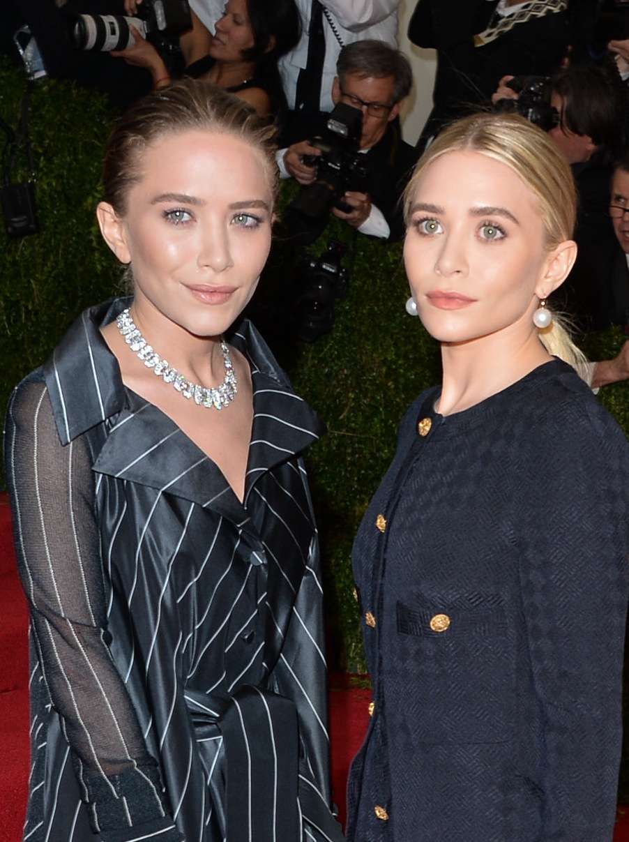 At the 2014 Met Gala, Mary Kate slicked her hair back into a loose bun while Ashley pulled hers back into a low ponytail.