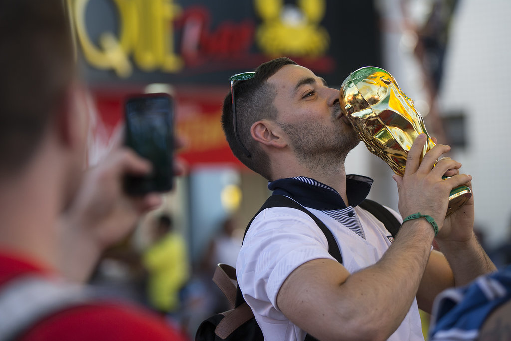 An England fan posed with a World Cup statue in Manaus, Brazil.