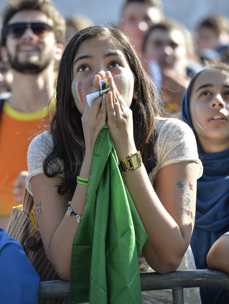 A fan of the Italian team looked anxious as she watched the game between Italy and Costa Rica.