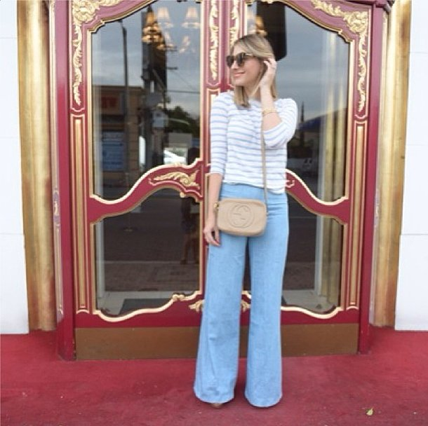 Flared denim and a striped tee are as easy as they are chic.  Source: Instagram user emilyschuman