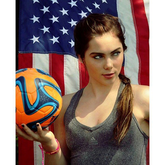 McKayla Maroney struck a sexy pose in front of an American flag.  Source: Instagram user mckaylamaroney