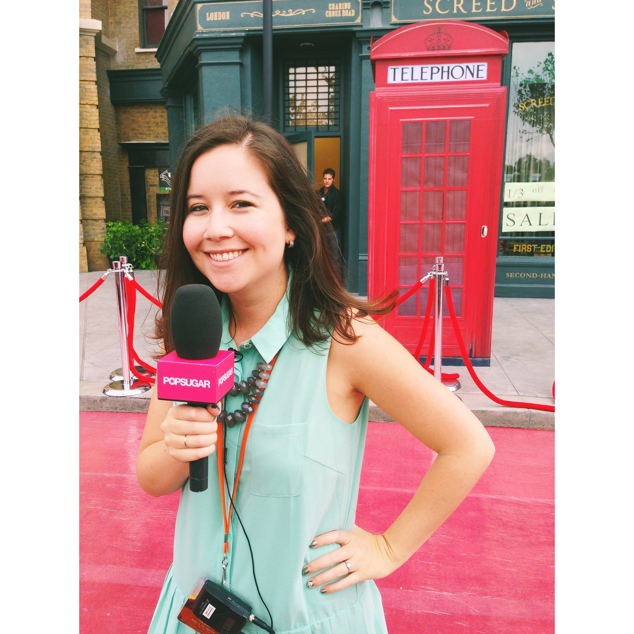 I posed in front of the red telephone box on the red carpet ahead of interviewing the stars of Harry Potter.