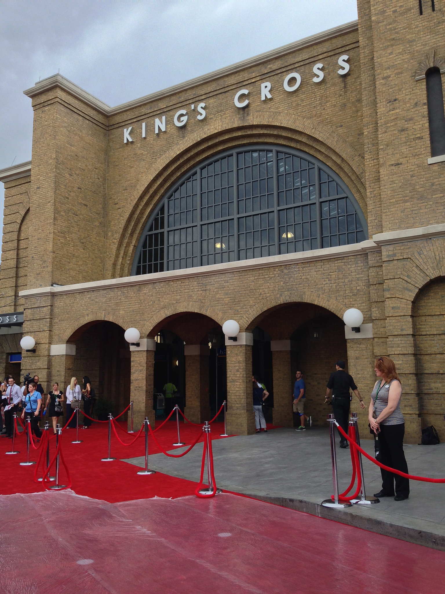 The red carpet in front of King's Cross Station gets prepped for the Harry Potter cast.