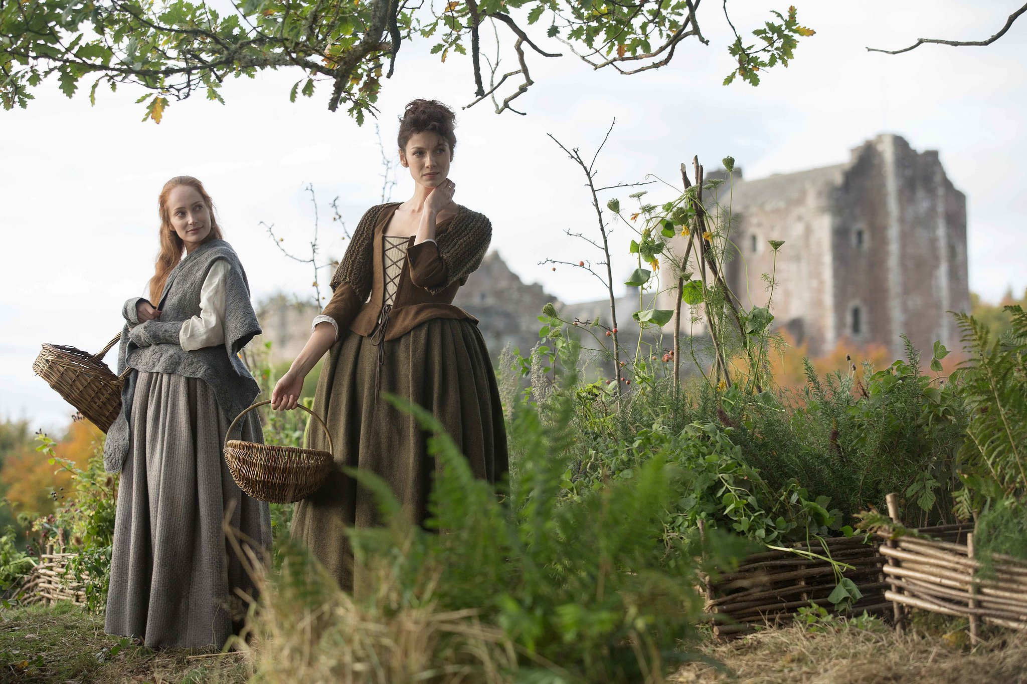 Claire and her newfound friend Geillis gather herbs. Courtesy of Starz