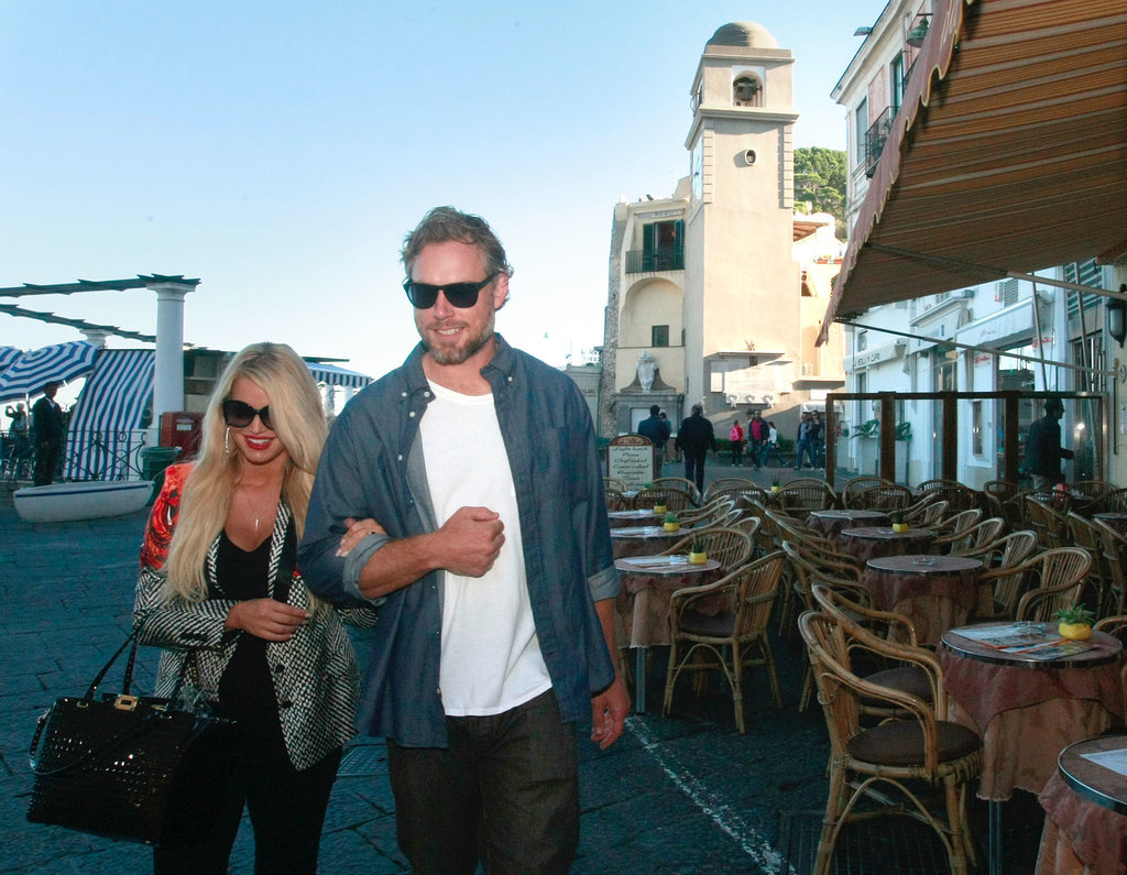 Eric and Jessica walked arm in arm during a vacation in Italy in October 2013.