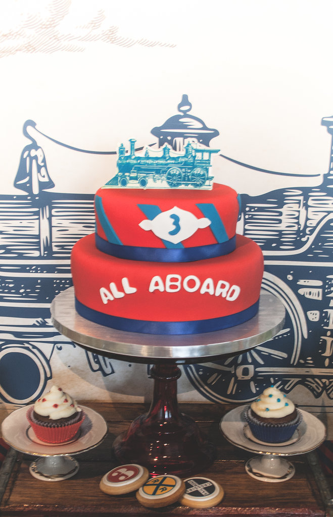 """The exquisite """"All Aboard"""" tiered cake was the work of Keren's Party Cakes.  Source:  Clay Williams and Alex Nirenberg for Keren Precel Events"""