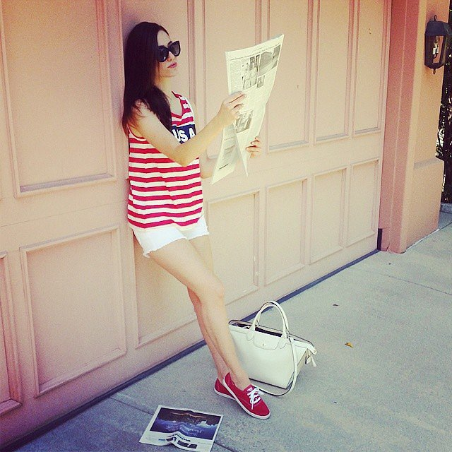 Emmy Rossum read The New York Times while sporting red, white, and blue. Source: Instagram user emmyrossum