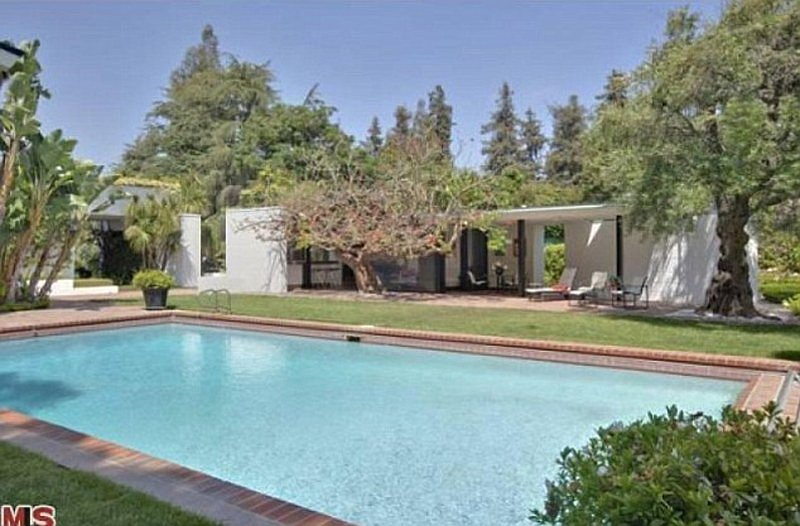 Yes, the pool is accompanied by a pool house!  Source: MLS