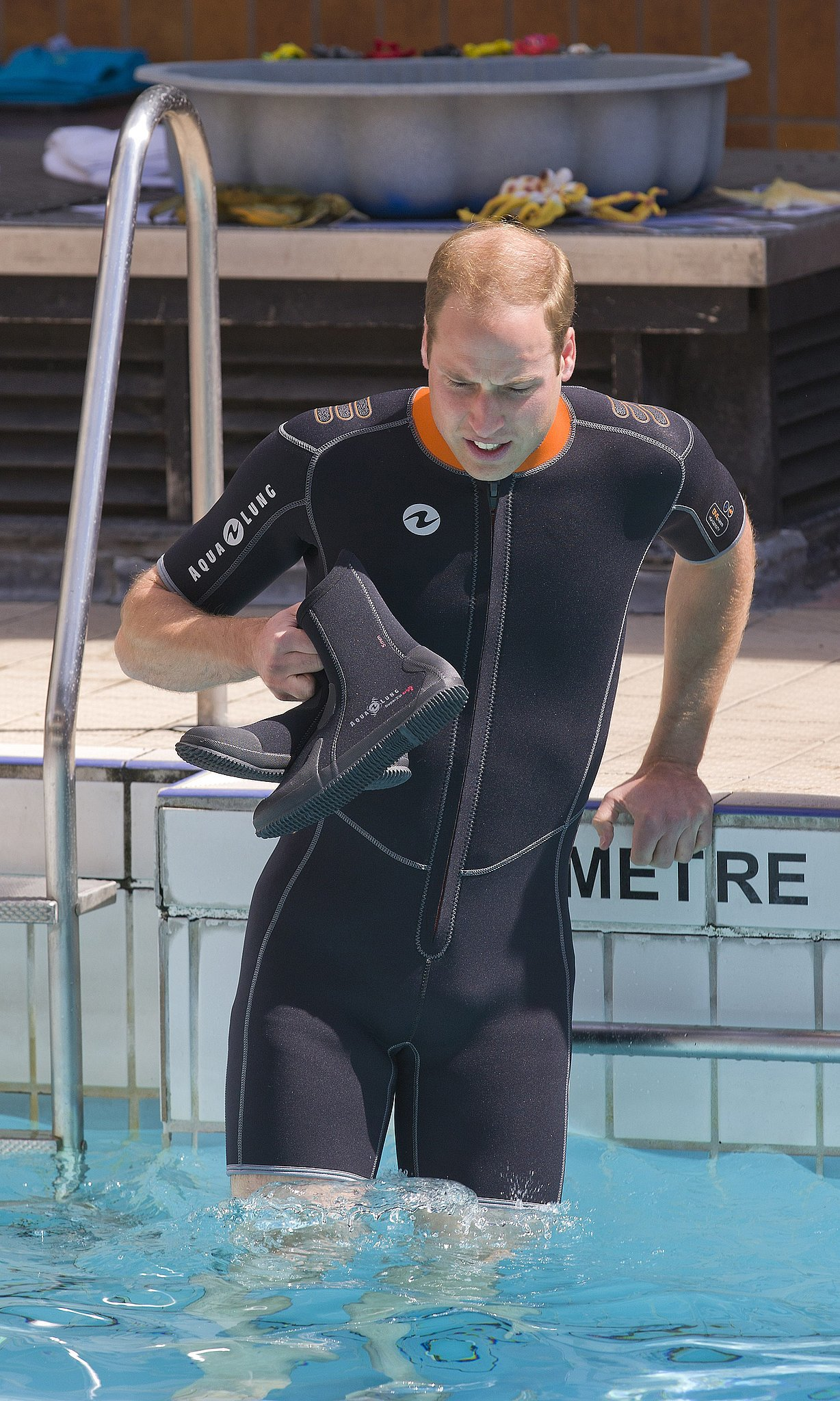 """Prince Charles Jokes About William's """"Buff"""" Physique in a Wetsuit"""