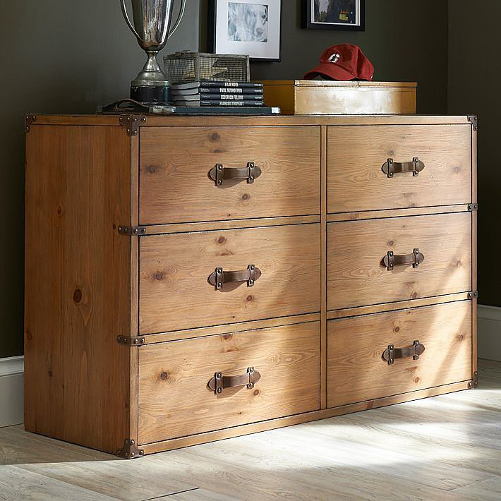 Heirloom pine and leather handles give this Travelers Dresser ($1,199-$2,995) a masculine vintage touch.