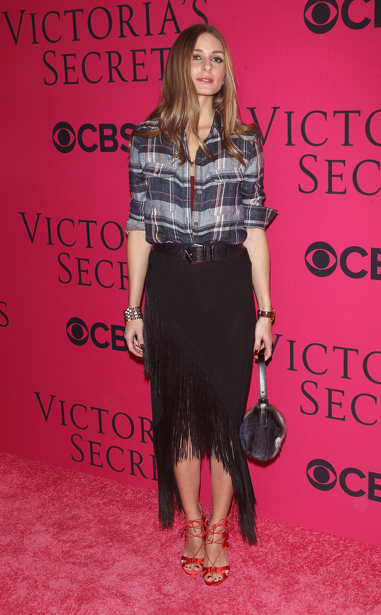 She doesn't care about the dress code, either. Who else would wear a plaid button-down to the Victoria's Secret Fashion Show?