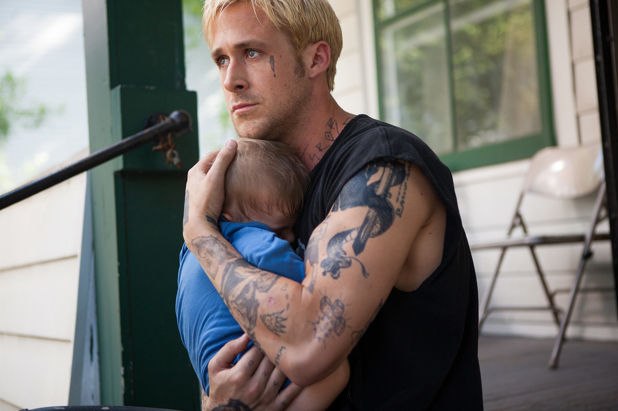 In The Place Beyond the Pines, a blond Ryan held onto his little boy.