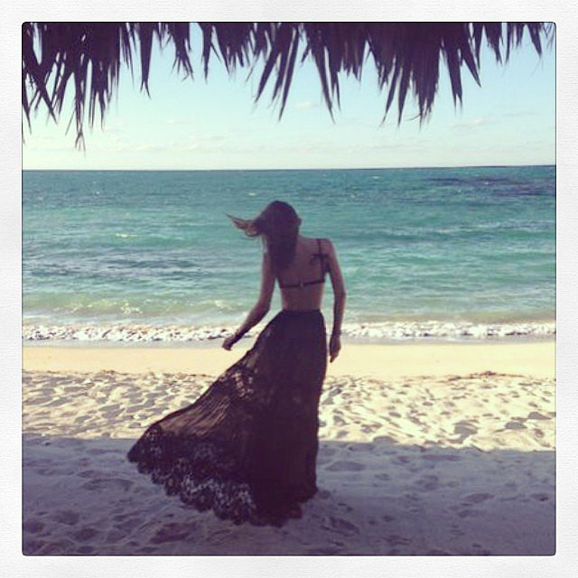 Miranda Kerr walked in the sand.  Source: Instagram user mirandakerr