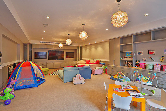 A look at the vast playroom.   Source: Trulia