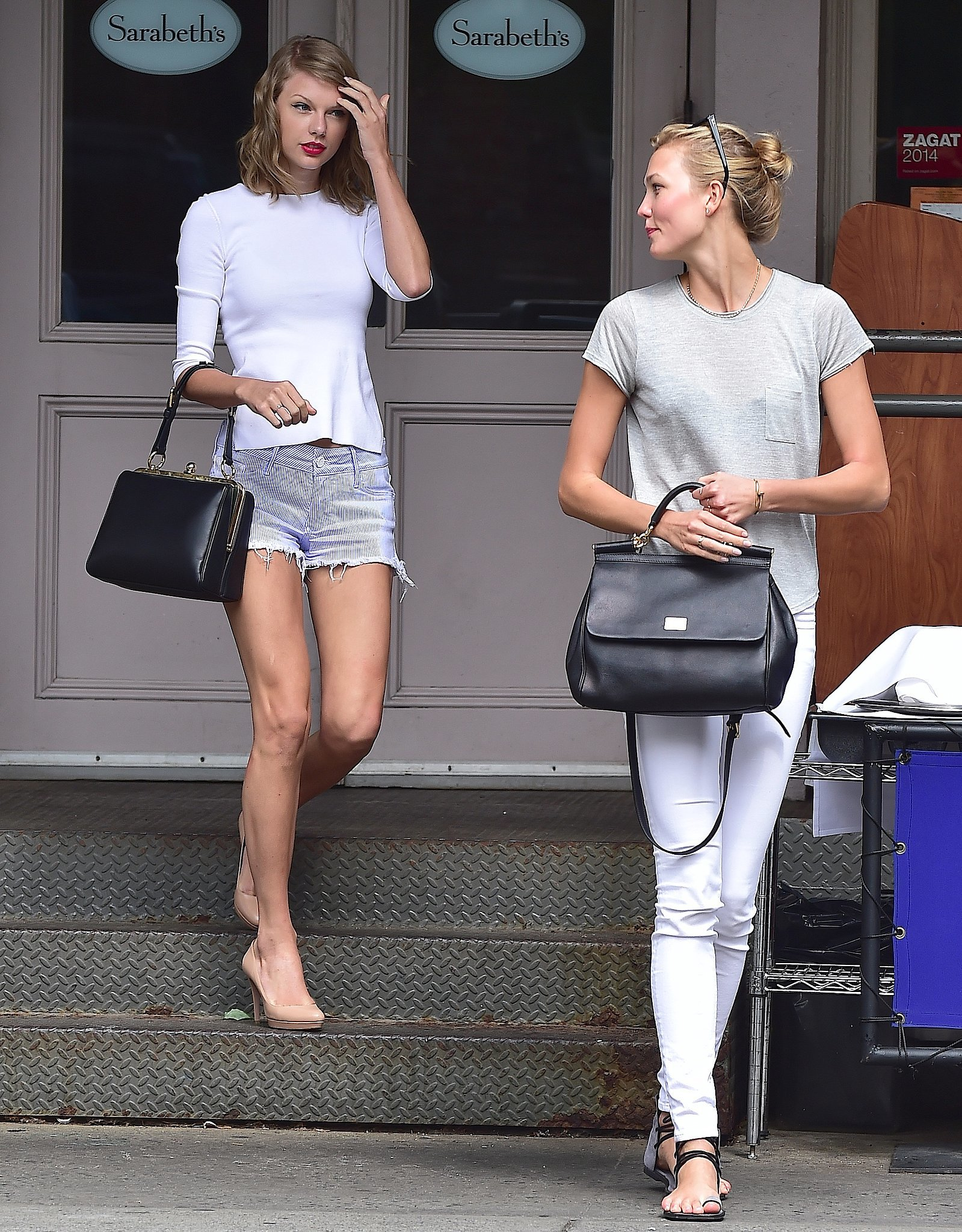It's not like we haven't seen Taylor and Karlie together before, but we're fawning over this particular sighting because, well, they're both carrying Dolce & Gabbana satchels — the Agata and the Sicily,respectively. Not only do each of the bags complement the girls' outfits, but they also jibe with Karlie's and Taylor's distinctive tastes. So decide which way you'd go — classic and sharp like Taylor or laid-back with a boho touch like Karlie — then scroll down to see how you can pull off both looks. Here's to all the fashion friends out there. Source: Getty / Alo Ceballos